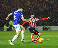 Lincoln City's Tom Pett gets a shot on target under pressure from Exeter City's Dara O'Shea<br /> <br /> Photographer Andrew Vaughan/CameraSport<br /> <br /> The EFL Sky Bet League Two - Lincoln City v Exeter City - Tuesday 26th February 2019 - Sincil Bank - Lincoln<br /> <br /> World Copyright © 2019 CameraSport. All rights reserved. 43 Linden Ave. Countesthorpe. Leicester. England. LE8 5PG - Tel: +44 (0) 116 277 4147 - admin@camerasport.com - www.camerasport.com