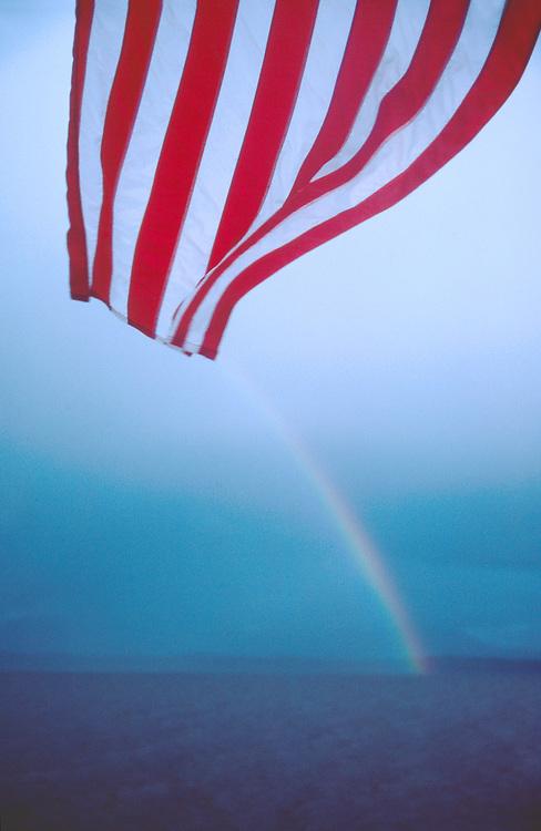 American Rainbow, Sea at dusk, Alaska, Inside Passage, American flag on the stern of the Alaska Ferry, Alaska Marine Highway,.