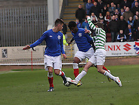 Junior Ogen being tackled by Aidan Nesbitt in the Celtic v Rangers City of Glasgow Cup Final match played at Firhill Stadium, Glasgow on 29.4.13,  organised by the Glasgow Football Association and sponsored by City Refrigeration Holdings Ltd.