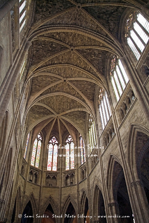 Vaulted ceilings and stained glass windows of Saint Andre Cathedral, Bordeaux, Aquitaine, France.