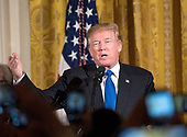 United States President Donald J. Trump makes remarks as he and first lady Melania Trump host a Chanukah reception in the East Room of the White House in Washington, DC on Thursday, December 7, 2017.<br /> Credit: Ron Sachs / CNP