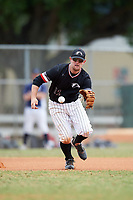 Edgewood College Eagles third baseman Tim Nunn (12) fields a ground ball during the second game of a doubleheader against Western Connecticut Colonials on March 13, 2017 at the Lee County Player Development Complex in Fort Myers, Florida.  Edgewood defeated Western Connecticut 2-1.  (Mike Janes/Four Seam Images)