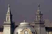 Sofia, Bulgaria. Roof tops; silver dome, towers and clock.