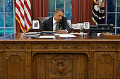United States President Barack Obama talks with Governor Rick Perry (Republican of Texas) to express his concern for citizens of that state impacted by the unprecedented fires, during a phone call in the Oval Office of the White House in Washington, D.C., September 7, 2011. .Mandatory Credit: Pete Souza - White House via CNP