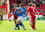 Aberdeen v St Johnstone... 23.07.11   SPL Week 1.David Robertson and Cillian Sheridan block Andrew Considine and Richie Foster.Picture by Graeme Hart..Copyright Perthshire Picture Agency.Tel: 01738 623350  Mobile: 07990 594431