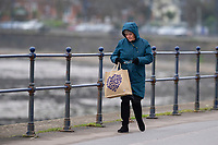 Pictured: A lady walks on Mumbles Sea Front, Swansea, Wales, UK. Thursday 31 January 2019<br /> Re: