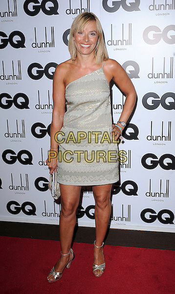 TANA RAMSAY .attending the GQ Men Of The Year  Awards 2008, Royal Opera House, London, England, .2nd September 2008..inside arrivals full length gold one shoulder dress hand on hip shoes ankle strap sandals .CAP/BEL.©Tom Belcher/Capital Pictures