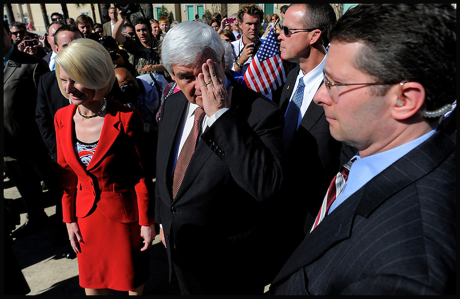 Former House speaker and Republican presidential candidate Newt Gingrich (C), accompanied by his wife Callista (L), takes a moment before approaching the microphones to address the media following a campaign stop at the Idlewild Baptist Church during in Lutz, Florida, USA, 29 January 2012. Republican candidates will campaign in Florida in the lead up to the Florida Primary on 31 January 2012.