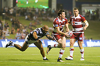 Picture by David Neilson/SWpix.com/PhotosportNZ - 10/02/2018 - Rugby League - Betfred Super League - Wigan Warriors v Hull FC  - WIN Stadium, Wollongong, Australia - Wigan's Joel Tomkins escapes the clutches of Hull FC's Sika Manu.