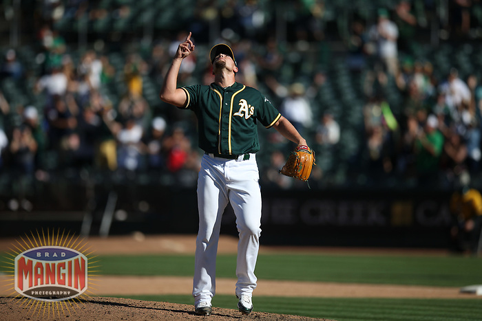 OAKLAND, CA - SEPTEMBER 8:  Blake Treinen #39 of the Oakland Athletics celebrates after the game against the Texas Rangers at the Oakland Coliseum on Saturday, September 8, 2018 in Oakland, California. (Photo by Brad Mangin)