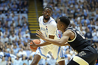 CHAPEL HILL, NC - MARCH 03: Brandon Robinson #4 of the University of North Carolina is defended by Andrien White #13 of Wake Forest University during a game between Wake Forest and North Carolina at Dean E. Smith Center on March 03, 2020 in Chapel Hill, North Carolina.