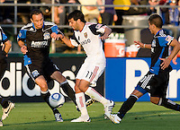 Ramiro Corrales of Earthquakes fights for the ball against Javier Morales of Real Salt Lake during the game at Buck Shaw Stadium in Santa Clara, California on March 27th, 2010.   Real Salt Lake defeated San Jose Earthquakes, 3-0.