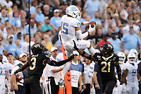 WINSTON-SALEM, NC - SEPTEMBER 13: Beau Corrales #15 of the University of North Carolina catches the ball above Nasir Greer #3 and Essang Bassey #21 of Wake Forest University during a game between University of North Carolina and Wake Forest University at BB