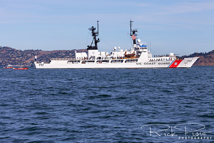 USCGC Mellon (WHEC-717), Hamilton-class high endurance cutter, enters San Francisco Bay with crew lining the rail.