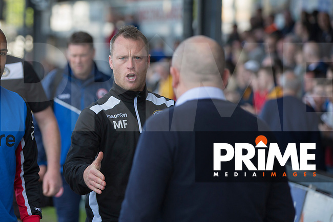 Newport County manager Mike Flynn greets Accrington Stanley manager John Coleman during the Sky Bet League 2 match between Newport County and Accrington Stanley at Rodney Parade, Newport, Wales on 22 April 2017. Photo by Mark  Hawkins.