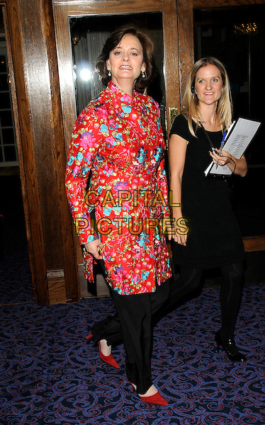 CHERIE BLAIR .Attending Breast Cancer Care's annual Fashion Show hosted by Gail Porter, Grosvenor House Hotel, London, England, UK,.7th October 2009..full length Booth red floral print embroidered tunic black over trousers pointy shoes funny mouth .CAP/CAN.©Can Nguyen/Capital Pictures.