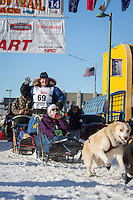 Abbie West and team leave the ceremonial start line at 4th Avenue and D street in downtown Anchorage during the 2014 Iditarod race.<br /> Photo by Jim R. Kohl/IditarodPhotos.com