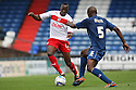 Lucas Akins of Stevenage takes on Jean-Yves Mvoto of Oldham . Oldham Athletic v Stevenage - npower League 1 -  Boundary Park, Oldham. - 25th August, 2012. © Kevin Coleman 2012