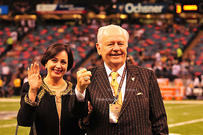 """World Champion New Orleans Saints owner Tom Benson shows off his Super Bowl Ring and his one of a kind hand made """"special """"pinstripe suit"""" The striping says """" New Orleans Saint World Champions"""" all over the  Black & Gold Suit!!! His wife Gayle , on his arm,had it made for him as a surpirse and he was presented it right before opening of the NFL season in New Orleans Louisiana Thurs Sept. 9,2010. The Saints beat the Minnessota Viking 14-9. Phot © Suzi Altman"""