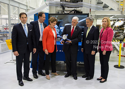 In this photo released by the National Aeronautics and Space Administration (NASA) United States Vice President Mike Pence receives a model of Orion from Acting NASA Administrator Robert Lightfoot, second from left, and NASA Kennedy Space Center (KSC) Director Robert D. Cabana, second from right, Thursday, July 6, 2017, while touring KSC's Operations and Checkout Building in Cape Canaveral, Florida. Also pictured are Sen. Marco Rubio (Republican of Florida), Marillyn Hewson, chairman, president and CEO of Lockheed Martin, third from left, and Janet Petro, KSC's deputy director, right.<br /> Mandatory Credit: Aubrey Gemignani / NASA via CNP