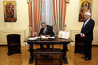Pictured L-R: US President Barack Obama signs the visitors' book with Greek President Prokopis Pavlopoulos. Tuesday 15 November 2016<br /> Re: US President Barack Obama attends official stat banquet at the Presidential Mansion during his visit to Athens Greece