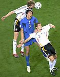04 July 2006: Luca Toni (ITA) (9) finds himself defended front and back by Per Mertesacker (GER) (17) and Arne Friedrich (GER) (3). Italy defeated Germany 2-0 in overtime at Signal Iduna Park, better known as Westfalenstadion, in Dortmund, Germany in match 61, the first semifinal game, in the 2006 FIFA World Cup.