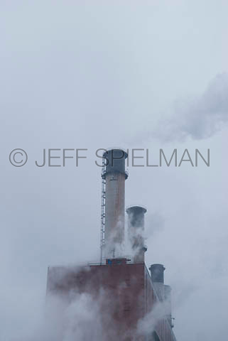THIS IMAGE IS AVAILABLE EXCLUSIVELY FROM CORBIS.....Please search for image 42-19641533 on www.corbis.com.....Power Plant and Smokestacks on an Overcast Day....New York City, New York State, USA