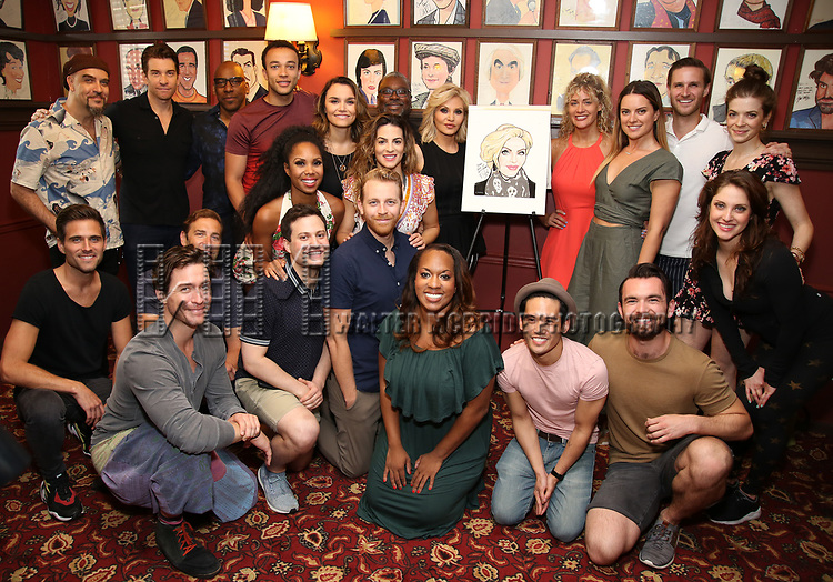 """Orfeh  with the cast of Broadway's """"Pretty Woman"""" during the Sardi's Portrait unveiling for Orfeh on July 18, 2019 in New York City."""