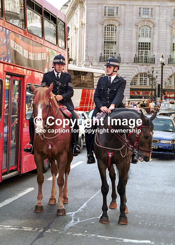Mounted police on patrol in central London, UK. Ref: 199808025..Copyright Image from Victor Patterson, 54 Dorchester Park, Belfast, UK, BT9 6RJ..Tel: +44 28 9066 1296.Mob: +44 7802 353836.Voicemail +44 20 8816 7153.Skype: victorpattersonbelfast.Email: victorpatterson@mac.com.Email: victorpatterson@ireland.com (back-up)..IMPORTANT: If you wish to use this image or any other of my images please go to www.victorpatterson.com and click on the Terms & Conditions. Then contact me by email or phone with the reference number(s) of the image(s) concerned.
