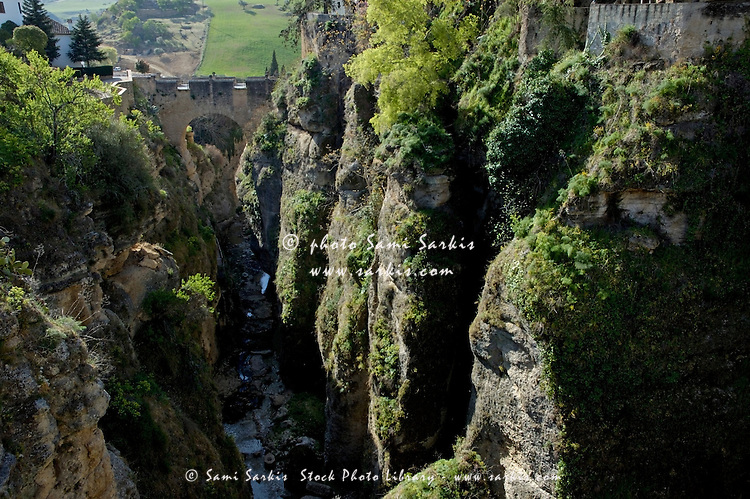 Built in 1616, Puente Viejo ('Old Bridge') spans El Tajo, the deep chasm that carries the Guadalevin River through Ronda, Andalusia, Spain.