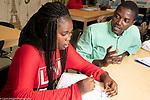 Education High School high school teacher talking to discouraged female student