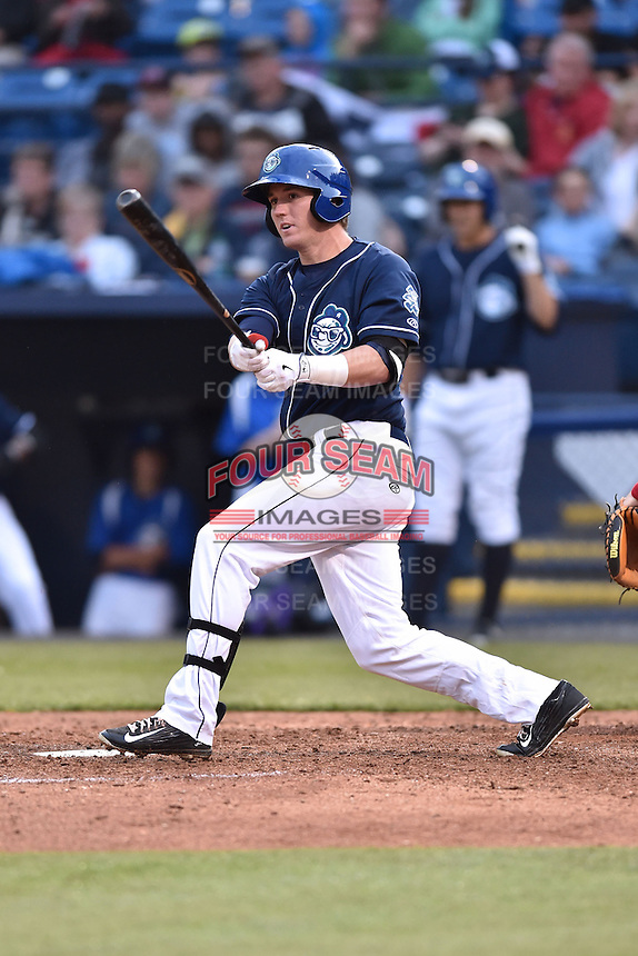 Asheville Tourists left fielder Drew Weeks (10) swings at a pitch during game one of a double header against the Greenville Drive on April 18, 2015 in Asheville, North Carolina. The Tourists defeated the Drive 2-1. (Tony Farlow/Four Seam Images)