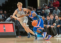 WASHINGTON, DC - DECEMBER 28: Mac McClung #2 of Georgetown defends against Jamir Harris #4 of American during a game between American University and Georgetown University at Capital One Arena on December 28, 2019 in Washington, DC.