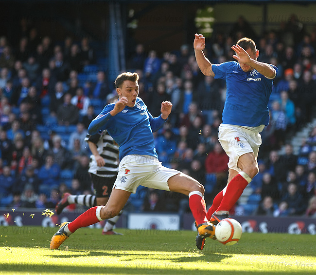 Kal Naismith steals the ball from Lee McCulloch who is preparing a shot