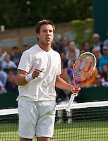 25-06-13, England, London,  AELTC, Wimbledon, Tennis, Wimbledon 2013, Day two, Igor Sijsling (NED) wins his first round and celebrates<br /> <br /> <br /> <br /> Photo: Henk Koster