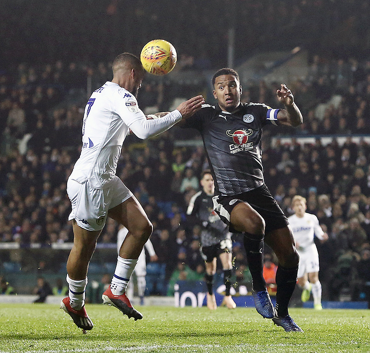 Leeds United's Kemar Roofe heads under pressure from Reading's Liam Moore<br /> <br /> Photographer Rich Linley/CameraSport<br /> <br /> The EFL Sky Bet Championship - Leeds United v Reading - Tuesday 27th November 2018 - Elland Road - Leeds<br /> <br /> World Copyright © 2018 CameraSport. All rights reserved. 43 Linden Ave. Countesthorpe. Leicester. England. LE8 5PG - Tel: +44 (0) 116 277 4147 - admin@camerasport.com - www.camerasport.com