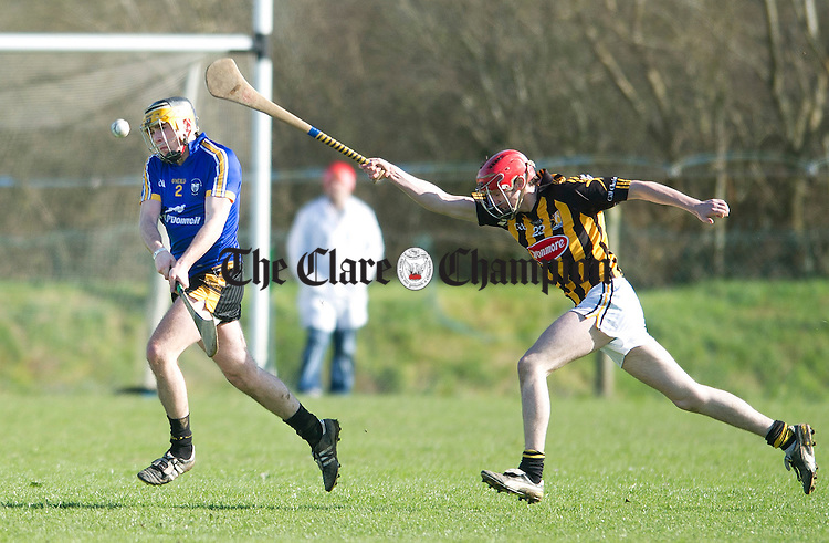 Eoin Meehan of Clonlara clears down the line as Conor Whelan closes in. Photograph by Declan Monaghan