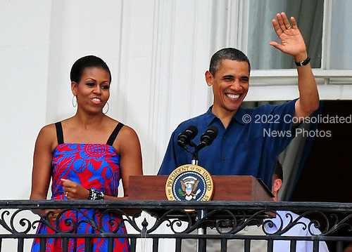United States President Barack Obama and First Lady Michelle Obama deliver remarks at an Independence Day barbeque for members of the armed services and White House staff and their families on the South Lawn of the White House in Washington on Monday, July 4, 2011. .Credit: Kevin Dietsch / Pool via CNP
