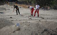 Pictured: Forensics officers and Hellenic Red Cross volunteers sift through soil in Kos, Greece. Wednesday 05 October 2016<br />