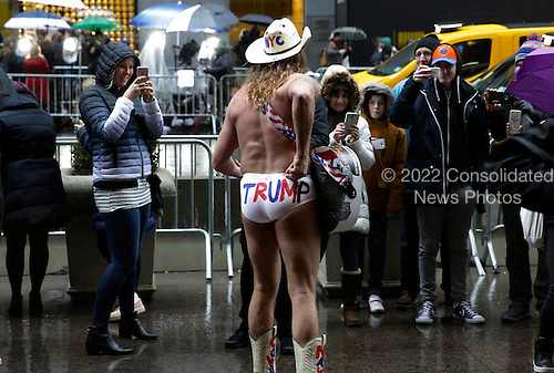 Robert John Burck, better known as the 'Naked Cowboy' performs in front of Trump Tower, in New York, New York, USA, 02 January 2017.<br /> Credit: Peter Foley / Pool via CNP