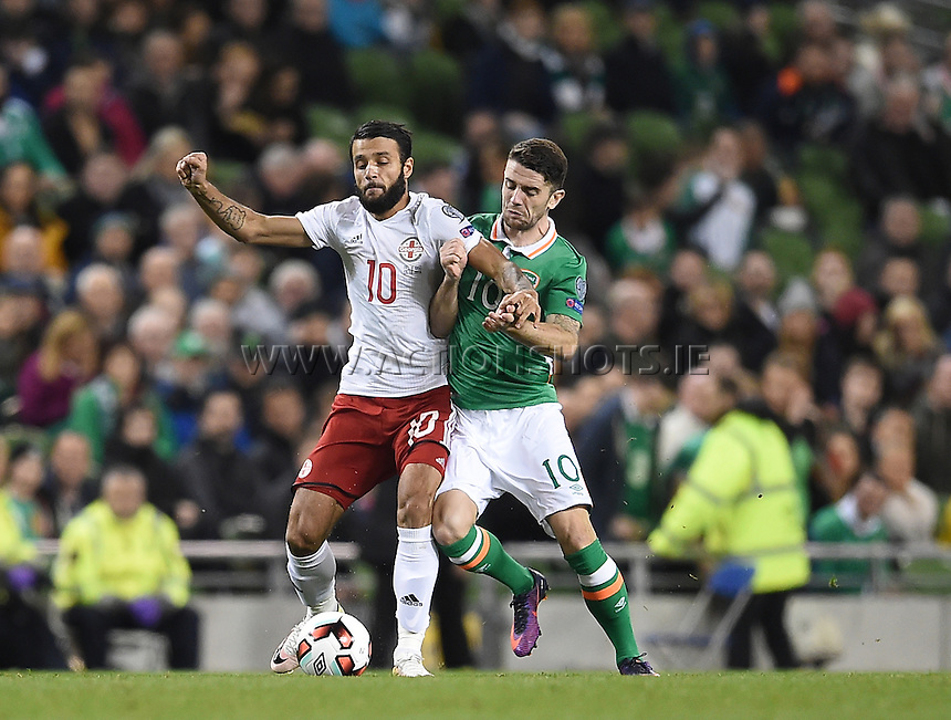 06/10/2016; 2018 FIFA World Cup Qualifier Republic of Ireland vs Georgia; Aviva Stadium, Dublin<br /> Georgia's Tornike Okriashvili with Robbie Brady of Ireland.<br /> Photo Credit: actionshots.ie/Tommy Grealy