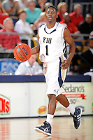 28 January 2012:  FIU guard Deric Hill (1) handles the ball in the second half as the Western Kentucky University Hilltoppers defeated the FIU Golden Panthers, 61-51, at the U.S. Century Bank Arena in Miami, Florida.