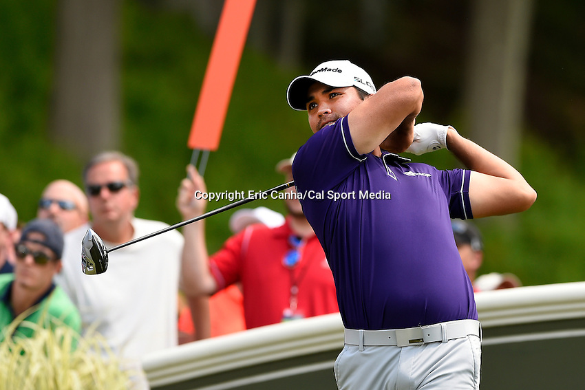 June 22, 2014 - Cromwell, Connecticut - Jason Day watches his ball on its way down the 18th fairway during the final round of the PGA Travelers Championship tournament held at TPC River Highlands in Cromwell, Connecticut.  Eric Canha/CSM