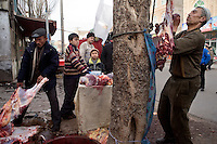 A butcher works outside of a small mosque in the Old City section of Kashgar, Xinjiang, China.
