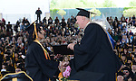 Western Nevada College President Chester Burton presents nursing graduate Jennifer Webb with her diploma during the 2015 Western Nevada College Commencement held at the Pony Express Pavilion in Carson City, Nev., on Monday, May 18, 2015.<br /> Photo by Tim Dunn