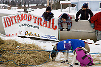 Elim School kids play in a boat and watch Sebastian Schunelles team rest on Tuesday afternoon during Iditarod 2008