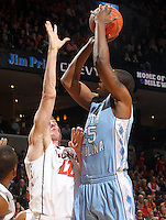 Jan. 8, 2011; Charlottesville, VA, USA;  North Carolina Tar Heels forward Justin Knox (25) shoots over Virginia Cavaliers forward Will Sherrill (22) during the game at the John Paul Jones Arena. Mandatory Credit: Andrew Shurtleff