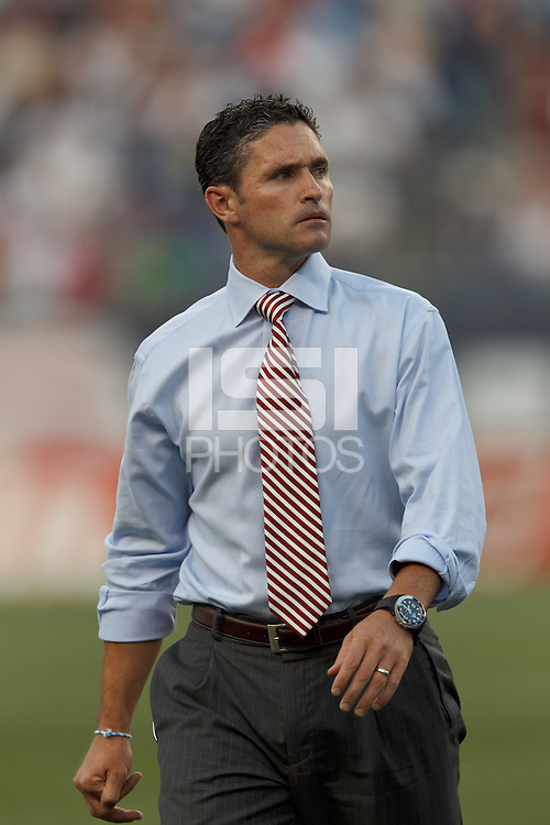 New England Revolution coach Jay Heaps. In a Major League Soccer (MLS) match, Sporting Kansas City defeated the New England Revolution, 1-0, at Gillette Stadium on August 4, 2012.