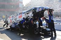 Jun. 15, 2012; Bristol, TN, USA: NHRA crew members for funny car driver Robert Hight during qualifying for the Thunder Valley Nationals at Bristol Dragway. Mandatory Credit: Mark J. Rebilas-