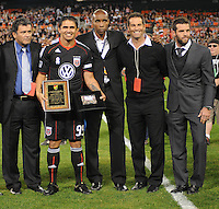 DC United forward Jaime Moreno (99) with former players from left to right Marco Etcheverry, Eddie Pope, John Harkes and Ben Olsen in the presentation of Jaime Moreno last game.  Toronto FC. defeated DC United 3-2 at RFK Stadium, October 23, 2010.